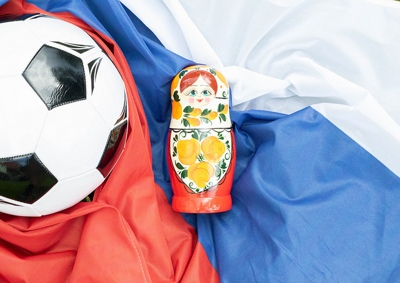 Russia flag, football and doll